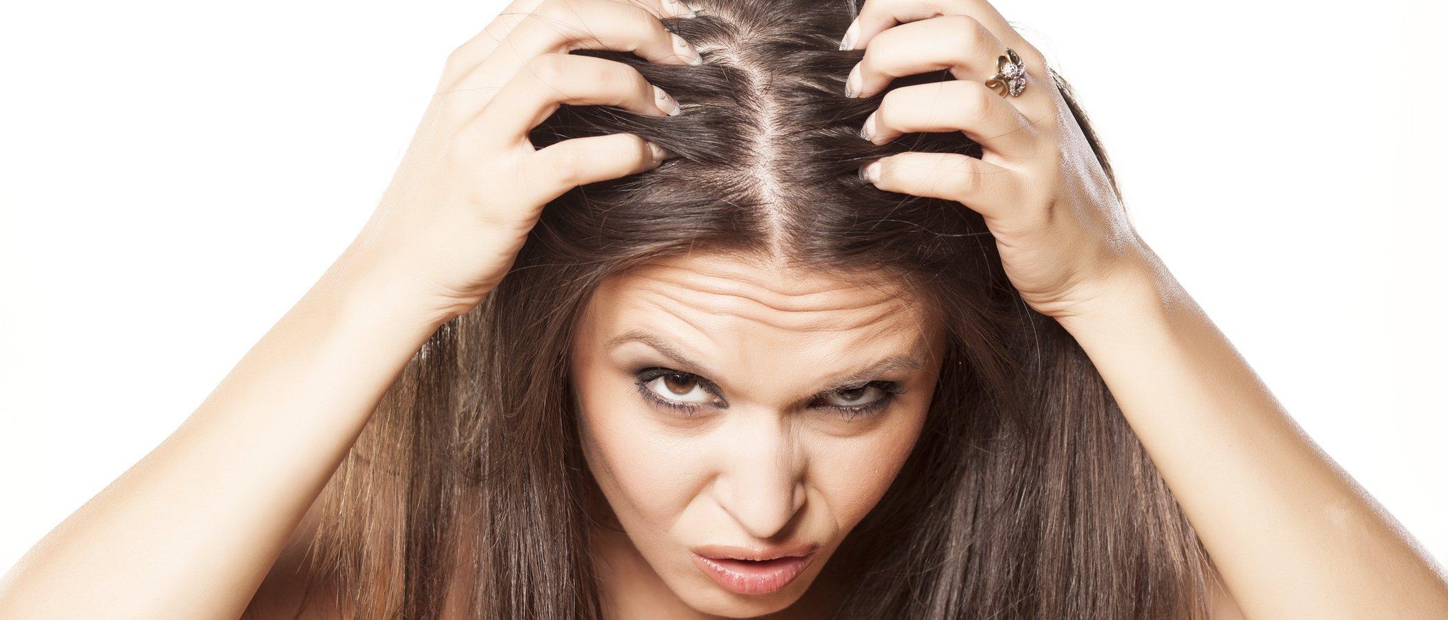 caída de cabello femenina